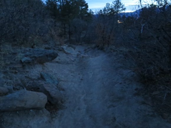 Dusk with no light on a rocky trail